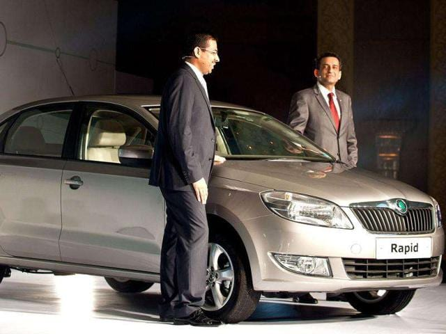 Head Marketing Skoda India Tarun Jha (R) and Associate Director Sales Ashutosh Dixit (L) pose with the newly unveiled Skoda Rapid in New Delhi. Skoda Auto India launched the Skoda Rapid sedan car in the Indian market with a starting price of Rs 6,75,000. AFP Photo/ Manan Vatsyayana