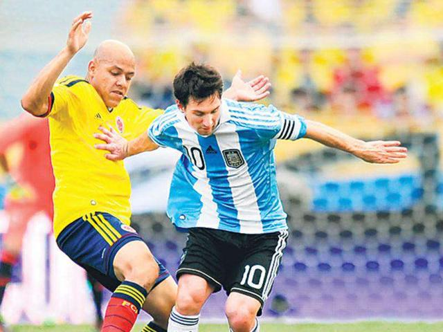 Argentina-s-Lionel-Messi-right-is-challenged-by-Colombia-s-Gustavo-Bolivar-during-their-World-Cup-qualifier--AFP-Photo