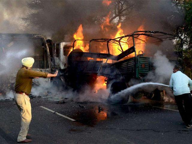 Firemen-douse-the-fire-after-a-head-on-collision-between-a-bus-carrying-the-Indian-Women-s-Kabaddi-team-and-an-Army-truck-at-cantonment-road-in-Bathinda
