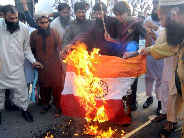 Activists-of-Pakistan-s-outlawed-Islamic-hardliner-party-Jamaat-ud-Dawa-JuD-burn-a-representation-of-the-Indian-flag-during-a-protest-rally-in-Lahore