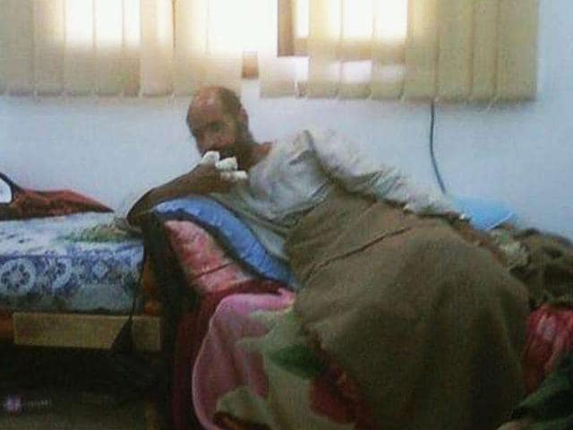 Saif-al-Islam-son-of-the-late-former-Libyan-leader-Muammar-Gaddafi-sits-after-his-capture-with-his-fingers-wrapped-in-bandages-and-his-legs-covered-with-a-blanket-at-an-undisclosed-location-in-this-photograph-aired-on-Free-Libya-TV