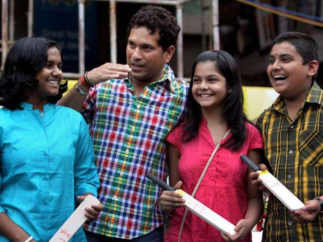 Master-blaster-Sachin-Tendulkar-interacts-with-children-during-the-opening-ceremony-of-an-educational-event-in-Mumbai