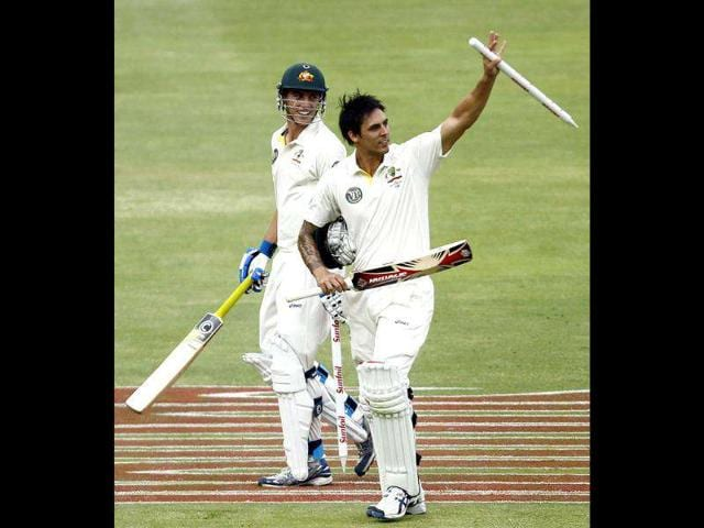 Australia-s-Patrick-Cummins-L-looks-on-as-Mitchell-Johnson-waves-at-the-end-of-the-fifth-day-of-the-second-Test-against-South-Africa-in-Johannesburg-Photo-Reuters-Siphiwe-Sibeko