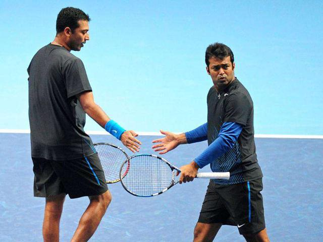 India-s-Mahesh-Bhupathi-L-touches-hands-with-his-partner-Leander-Paes-R-after-a-point-against-Robert-Lindstedt-of-Sweden-and-his-partner-Horia-Tecau-of-Romania-during-their-group-A-doubles-match-at-the-ATP-World-Tour-Finals-in-London-AFP-Photo-Leon-Neal