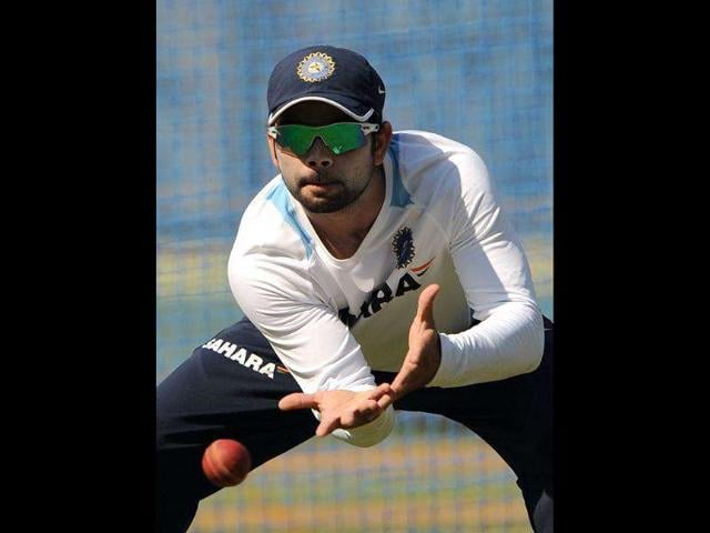 Cricketer-Virat-Kohli-catches-a-ball-during-a-practice-session-at-the-Wankhede-stadium-in-Mumbai-AFP-Photo-Punit-Paranjpe