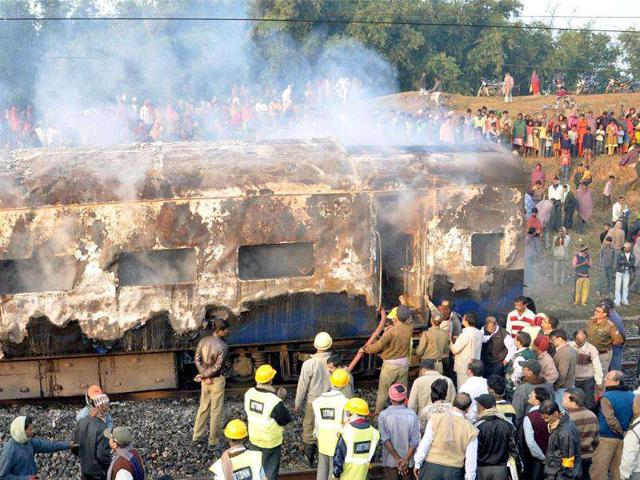 Firemen-extinguishing-the-fire-in-one-of-the-two-AC-coaches-of-the-Howrah-Dehradun-Express-train-in-Giridih-district-of-Jharkhand-PTI-Photo