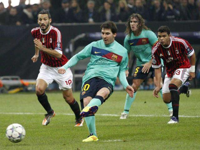Barcelona-forward-Lionel-Messi-kicks-a-penalty-during-a-Champions-League-Group-H-soccer-match-between-AC-Milan-and-Barcelona-at-the-San-Siro-stadium-in-Milan-Italy