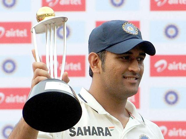 Indian-team-cricket-captain-Mahendra-Singh-Dhoni-poses-with-the-trophy-after-India-won-the-three-test-cricket-match-series-against-West-Indies-by-2-0-at-the-Wankhede-stadium-in-Mumbai-AFP-PHOTO-Punit-PARANJPE-
