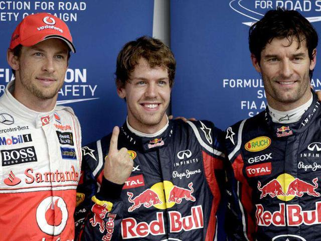 Red-Bull-driver-Sebastian-Vettel-of-Germany-center-poses-for-photos-with-Red-Bull-driver-Mark-Webber-of-Australia-right-and-McLaren-Mercedes-driver-Jenson-Button-of-Britain-left-at-the-Interlagos-race-track-in-Sao-Paulo-Brazil-Webber-was-second-and-Button-third-The-Brazilian-Formula-One-Grand-Prix-will-take-place-on-Sunday-AP-Photo-Victor-R-Caivano