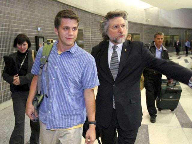 Gregory-Porter-center-one-of-three-US-students-arrested-during-a-demonstration-in-Cairo-Egypt-walks-beside-his-attorney-Theodore-Simon-after-arriving-at-Philadelphia-International-Airport-in-Philadelphia