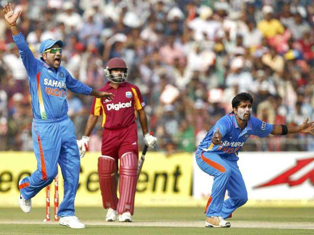 Vinay-Kumar-R-and-his-teammate-Rohit-Sharma-L-appeal-successfully-for-the-wicket-of-West-Indies-Adrian-Barath-during-their-first-one-day-international-cricket-match-in-Cuttack