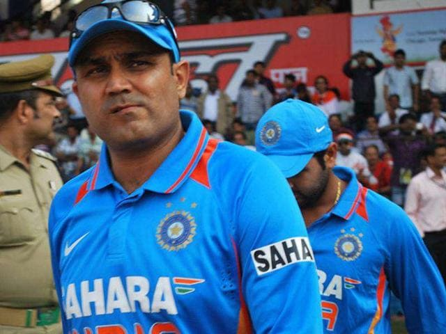 Virender-Sehwag-with-teammates-coming-into-the-field-to-play-their-1st-ODI-against-West-Indies-at-Barbati-Stadium-in-Cuttack