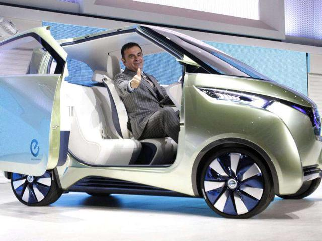 Carlos Ghosn, chairman and CEO of Nissan and Renault, poses in Nissan's new concept car PIVO3 at the 42nd Tokyo Motor Show in Tokyo.