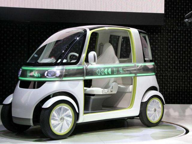 A video cameraman shoots Daihatsu Motor Co., concept car 'PICO' on display at the Tokyo Motor Show in Tokyo.