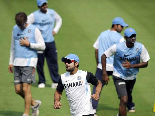 Virat-Kohli-C-with-teammates-plays-a-game-of-football-during-a-training-session-ahead-of-the-second-ODI-match-between-India-and-West-Indies-at-the-Dr-YS-Rajasekhara-Reddy-Cricket-Stadium-in-Visakhapatnam