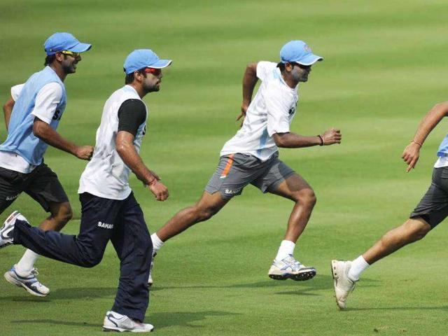 Manoj-Tiwary-L-Virat-Kohli-C-R-Vinay-Kumar-2R-and-Rohit-Sharma-play-a-game-of-football-during-a-training-session-ahead-of-the-second-ODI-match-between-India-and-West-Indies-at-the-Dr-YS-Rajasekhara-Reddy-Cricket-Stadium-in-Visakhapatnam