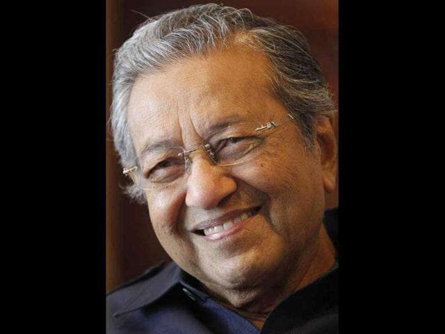 Former-Malaysia-s-prime-minister-Mahathir-Mohamad-smiles-as-he-speaks-at-his-office-in-Putrajaya-outside-Kuala-The-man-who-made-Malaysia-part-of-the-East-Asia-Miracle-with-a-massive-inflow-of-foreign-direct-investment-doesn-t-think-much-of-it-today-Reuters-Bazuki-Muhammad