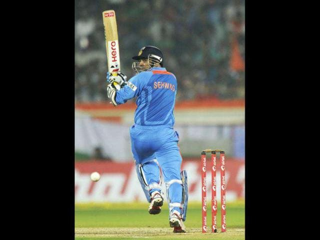Indian-cricketer-Virender-Sehwag-plays-a-shot-during-the-second-One-Day-International-ODI-match-between-India-and-the-West-Indies-at-The-YS-Rajasekhara-Reddy-cricket-stadium-in-Visakhapatnam