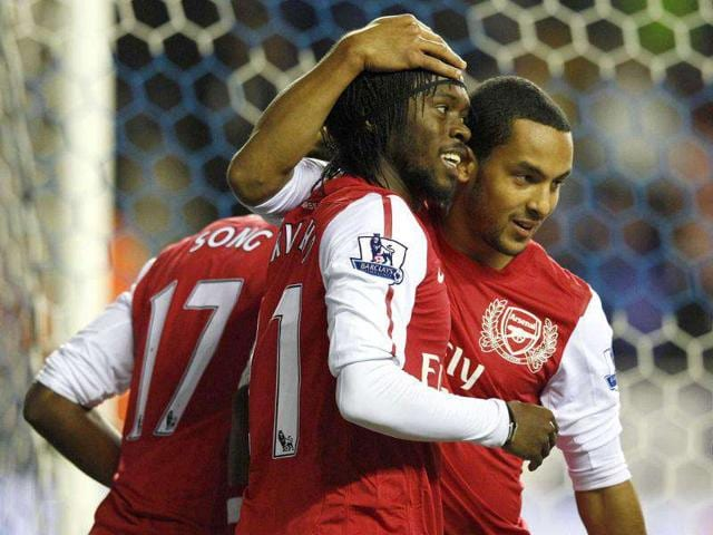Arsenal-s-Gervinho-celebrates-with-Theo-Walcott-R-after-scoring-his-side-s-third-goal-during-their-English-Premier-League-soccer-match-against-Wigan-Athletic-at-the-DW-Stadium-in-Wigan-northern-England-Reuters-Phil-Noble