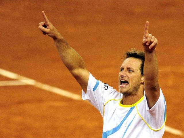 Argentina-s-David-Nalbandian-celebrates-after-winning-the-Davis-Cup-final-doubles-match-with-teammate-Eduardo-Schwank-against-Spain-s-Feliciano-Lopez-and-Fernando-Verdasco-at-La-Cartuja-Olympic-stadium-in-Sevilla-AFP-Photo-Javier-Soriano