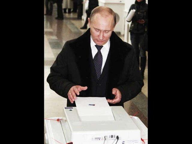 Russia-s-Prime-Minister-Vladimir-Putin-casts-his-ballot-at-a-polling-station-during-the-parliamentary-election-in-the-capital-Moscow