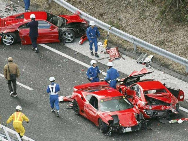 Police-officers-investigate-wrecked-luxury-cars-on-the-Chugoku-Expressway-in-southwestern-Japan-Ten-people-were-slightly-injured-in-the-pile-up-involving-eight-Ferraris-a-Lamborghini-two-Mercedes-Benz-and-two-Japanese-cars