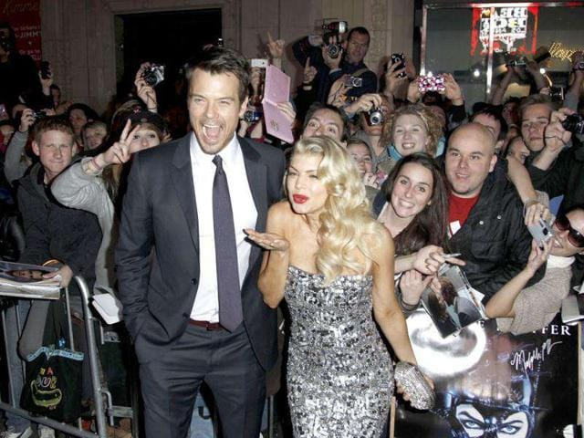 Josh-Duhamel-and-Fergie-arrive-at-the-premiere-of-New-Year-s-Eve-in-Los-Angeles-AP-Photo-Matt-Sayles