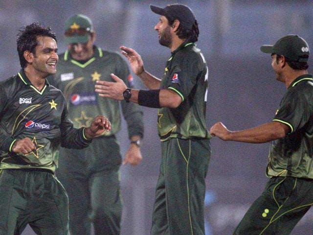 Pakistan-s-Shahid-Afridi-2ndR-celebrates-with-Mohammad-Hafeez-L-the-dismissal-of-Bangladesh-s-Nasir-Hossain-unseen-during-their-third-one-day-international-cricket-match-in-Chittagong-Bangladesh-AP-Photo-Pavel-Rahman