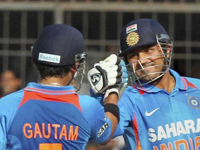 Virender-Sehwag-and-Gautam-Gambhir-during-the-4th-ODI-cricket-match-against-West-Indies-at-the-Holkar-stadium-in-Indore-PTI-Photo
