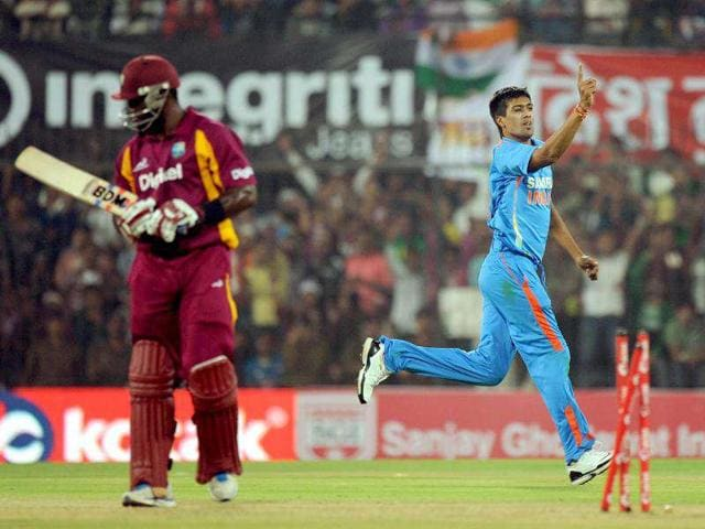 Rahul-Sharma-bowls-during-the-fourth-one-day-international-cricket-match-against-West-Indies-at-The-Holkar-Stadium-in-Indore-AFP-Photo