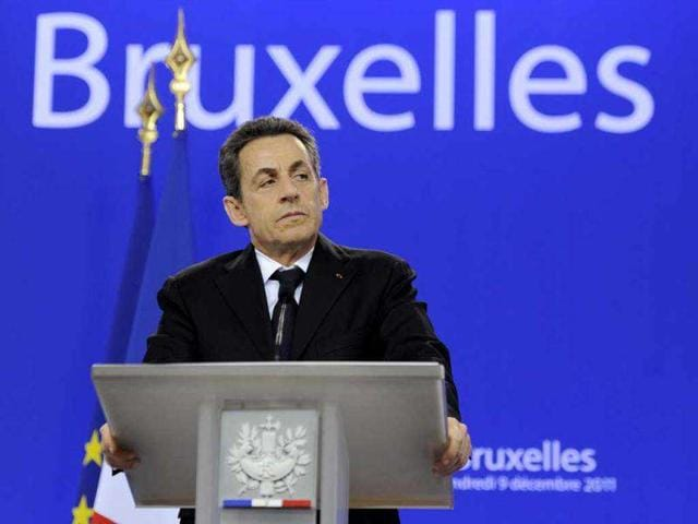 France--president-Nicolas-Sarkozy-gives-a-press-conference-after-talks-gathering-European-Union-EU-heads-of-State-or-government-during-an-European-Union-summit-at-the-EU-headquarters--in-Brussels-European-Union-leaders-abandoned-a-bid-to-convince-Britain-to-change-the-bloc-s-treaty-to-combat-the-eurozone-debt-crisis-Talks-would-now-go-forward-seeking-a-new-inter-governmental-agreement-designed-for-the-17-countries-that-make-up-the-eurozone-and-others-aiming-to-join-the-currency-union---AFP-PHOTO-ERIC-FEFERBERG
