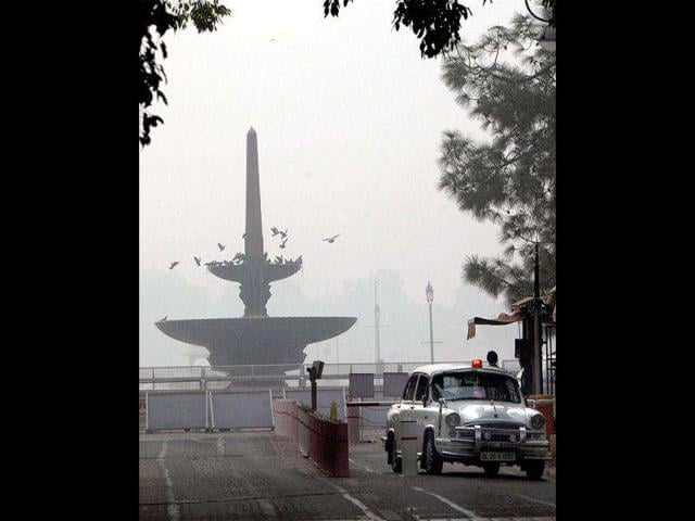 A-VIP-vehicle-enters-Parliament-as-a-blanket-of-fog-covers-the-Vijay-Chowk-in-New-Delhi
