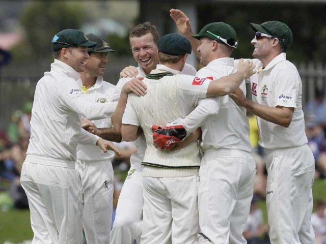 Australian-strike-bowler-Peter-Siddle-3rd-L-is-swamped-by-teammates-after-dismissing-New-Zealand-s-Martin-Guptill-unseen-for-16-in-their-second-Test-cricket-match-in-Hobart-Australia-AP-Photo-Chris-Crerar