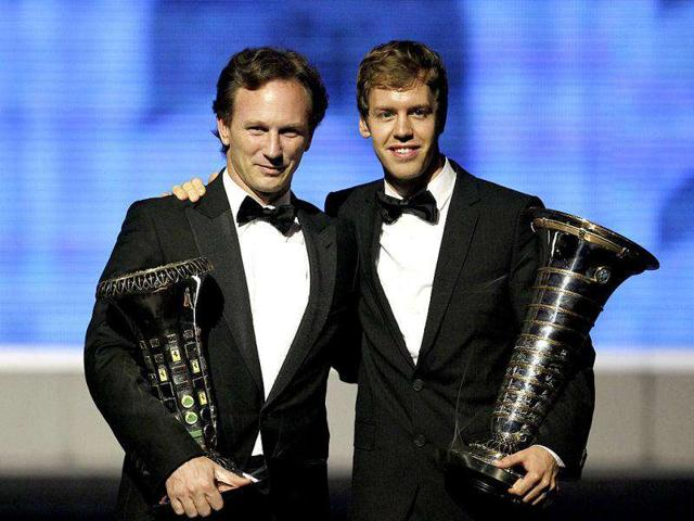 Red-Bull-Formula-One-driver-Sebastian-Vettel-left-with-FIA-World-Rally-Champion-during-the-2011-FIA-Gala-awards-ceremony-in-Gurgaon