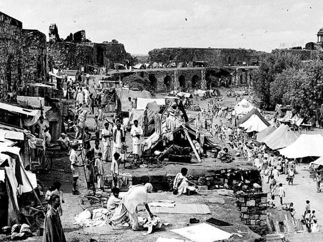 In this photograph taken September 22, 1947, Mahatma Gandhi  visits Muslim refugees at Purana Qila in New Delhi, as they prepare to depart to Pakistan