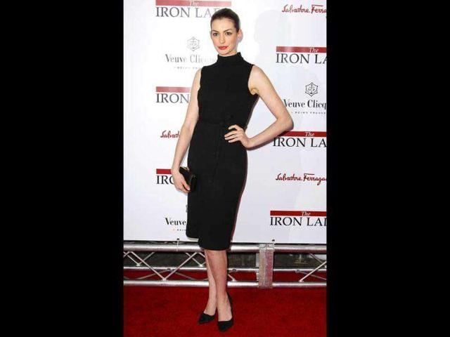 Actor-Anne-Hathaway-looked-elegant-in-a-black-dress-that-contrasted-beautifully-with-the-red-carpet-Reuters