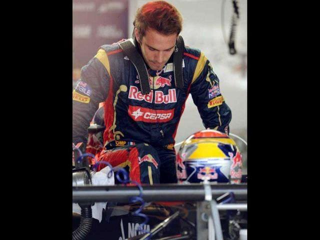 File-photo-of-French-F-1-driver-Jean-Eric-Vergne-getting-into-his-Toro-Rosso-s-cockpit-in-Sao-Paulo-AFP-Antonio-Scorza