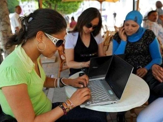 Tunisian-girls-check-their-computers-in-a-Wi-Fi-cafe-on-the-Habib-Bourguiba-Avenue-in-Tunis-AFP-Fethi-Belaid