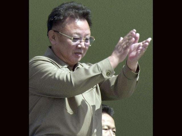 FILE-North-Korean-leader-Kim-Jong-Il-claps-from-the-balcony-as-soldiers-salute-him-during-a-military-parade-celebrating-the-foundation-of-the-armed-forces-in-Pyongyang-North-Korea