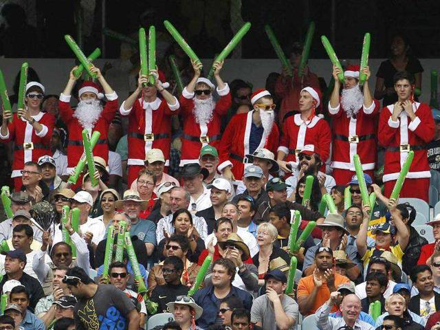 Spectators-dressed-in-Santa-suits-react-during-the-first-day-of-the-first-cricket-Test-match-between-Australia-and-India-at-the-Melbourne-Cricket-Ground-Reuters-Photo