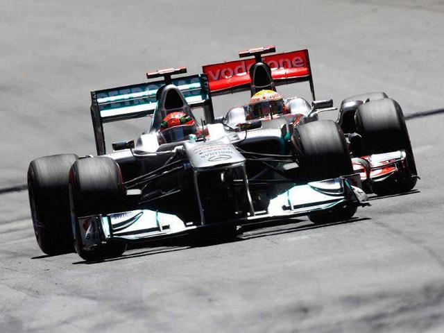 Michael-Schumacher-holding-off-Lewis-Hamilton-at-this-year-s-Monaco-GP