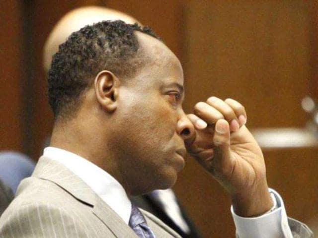 Conrad-Murray-wipes-a-tear-during-the-defense-opening-arguments-in-his-involuntary-manslaughter-trial-in-Los-Angeles-California-Superior-Court-on-September-27-2011-Michael-Jackson-s-doctor-was-guilty-of-gross-negligence-which-led-to-the-pop-icon-s-death-AFP