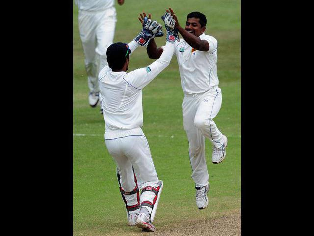 Sri-Lanka-s-Dinesh-Chandimal-celebrates-with-Rangana-Herath-after-taking-the-wicket-of-South-Africa-s-Jacques-Kallis-during-their-second-five-day-cricket-test-match-in-Durban-AP-Photo