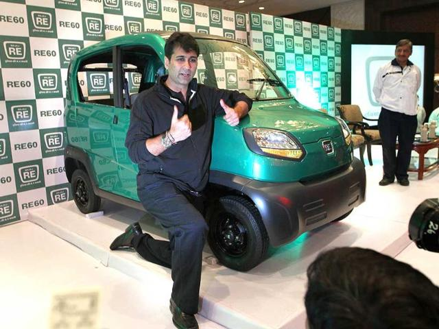 Managing Director of India's Bajaj Auto Rajiv Bajaj addresses media representatives as he poses with newly launched vehicle - RE60 at a function in New Delhi. HT Photo/ Arvind Yadav