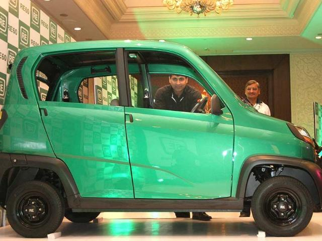 Bajaj's Managing Director Rajiv Bajaj is seen through the windows of the newly launched first-ever four-wheeled vehicle RE60 in New Delhi. Reuters/B Mathur