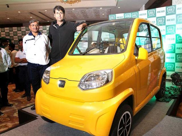 Managing Director of India's Bajaj Auto Rajiv Bajaj addresses media representatives as he poses with newly launched vehicle - RE60 at a function in New Delhi. HT Photo/Arvind Yadav