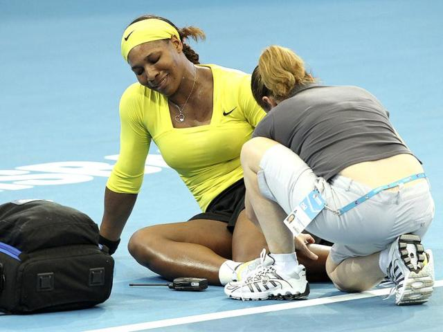 Serena-Williams-receives-medical-attention-after-twisting-her-left-ankle-in-her-match-against-Bojana-Jovanovski-during-the-Brisbane-International-tennis-tournament-in-Brisbane-AP-Tertius-Pickard
