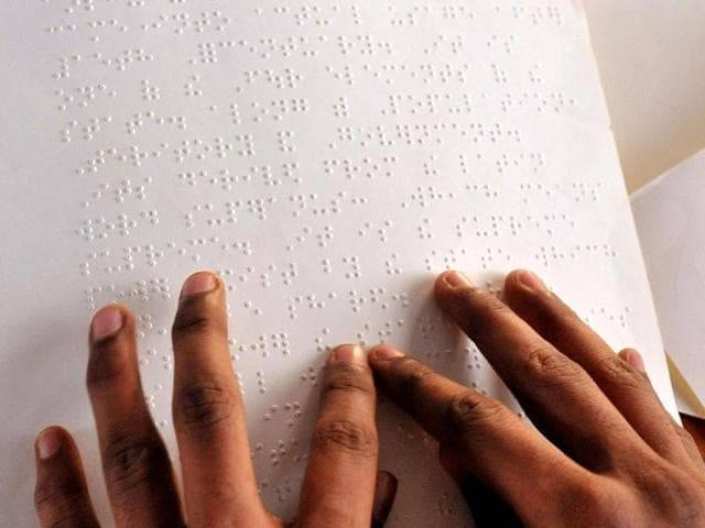 A-visually-impaired-person-reads-using-the-Braille-system-at-Sai-Junior-College-for-Blind-in-Hyderabad-on-the-203rd-birth-anniversary-of-its-French-inventor-Louis-Braille-AFP-Photo-Noah-Seelam