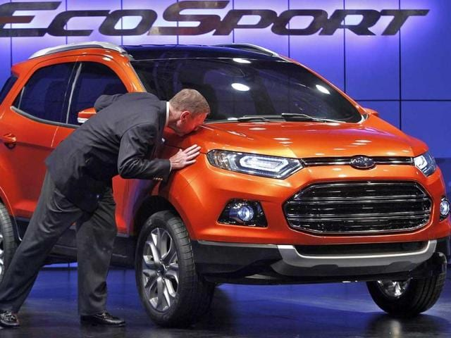 Alan-Mulally-President-and-CEO-of-Ford-Motor-Company-kisses-the-newly-launched-EcoSport-vehicle-in-New-Delhi-Ford-Motor-Co-on-Wednesday-launched-the-EcoSport-its-new-global-compact-sports-utility-vehicle-and-said-it-will-invest-142-million-in-the-company-s-Chennai-plant-in-south-India-to-manufacture-the-model-for-the-domestic-and-export-markets-REUTERS-Adnan-Abidi
