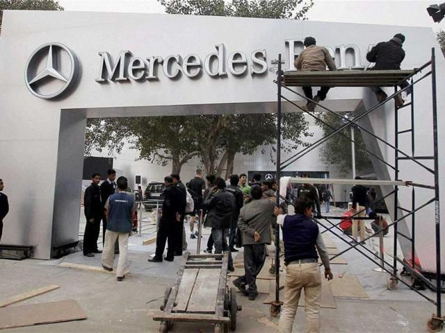 Workers prepare the stall of Mercedes Benz for the Auto Expo 2012 at Pragati Maidan in New Delhi. PTI Photo/ Manvender Vashit